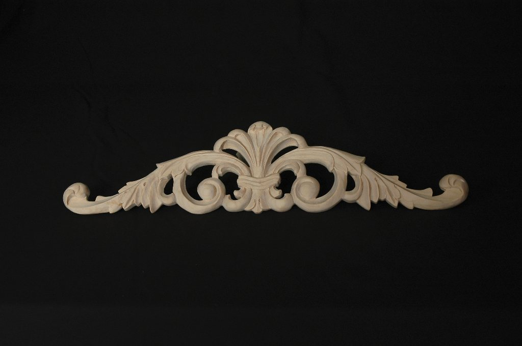 "This beautiful, hand carved acanthus leaf onlay is a great addition to any kitchen, bathroom, or entryway. Each piece is individually hand carved from solid maple by some of the world's most respected craftsmen. With incredible detail it is ready for stain, faux, glazing, or paint. 5""H x 20""W x 1/2""D"